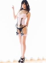 Appealing Natsuki Yokoyama is posing in pink stockings and black lingerie