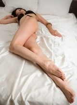 Ryo Yuuki rests on a bed before putting on her pantyhose and masturbating a lot