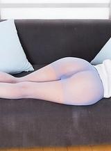 Brunette stunner Aki Tojo using pantyhosed feet to make him cum all over her